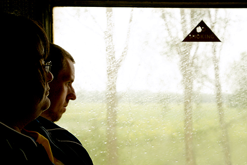 Train passengers on a rainy day on the Kent and East Sussex railway