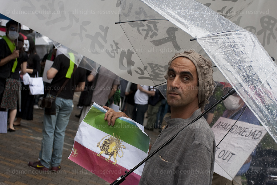 A marcher holds an alternative Iranian flag at a Pro Iranian democracy demonstration Tokyo, Japan, June 28th 2009