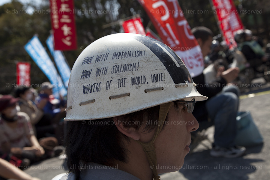 helmet with a hopeful message at left wing demo in Tokyo